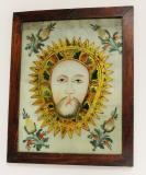 Veraikona, Disk tváře Ježíšovy, okolo symbolická zlatá záře na bílém podkladě. Kladsko, 2. polovina 19. století. Sbírka OM.